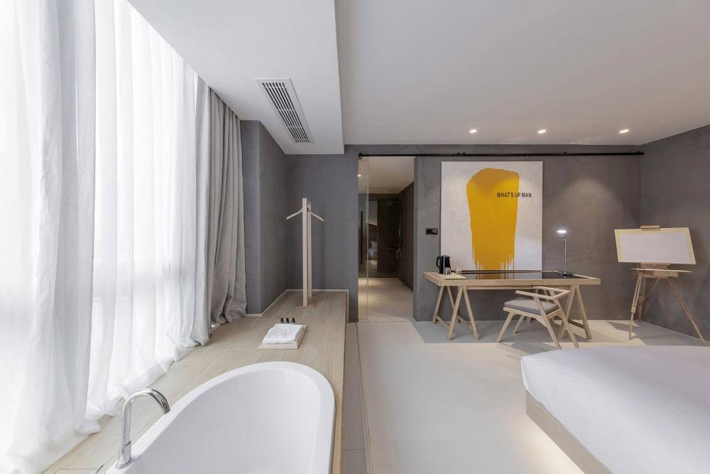 the-wheat-youth-arts-hotel-li-xiang-binjiang-district-hangzhou-zhejiang_dezeen_2364_col_0